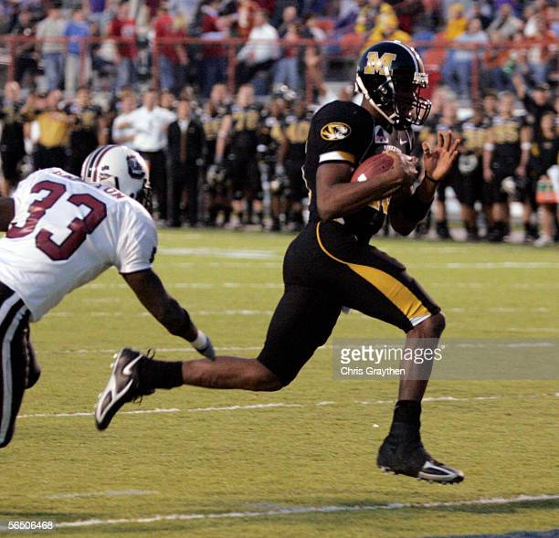 Quarterback Brad Smith of Missouri Tigers runs in for a touchdown around Chris Hampton of South Carolina during the Independence Bowl on December 30,...