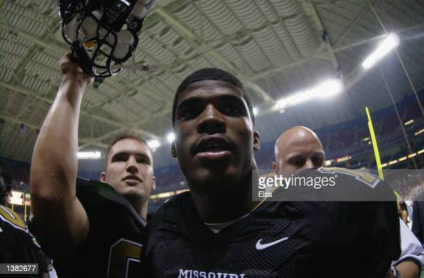 Quarterback Brad Smith of the Missouri Tigers celebrates their win over the Illinois Fighting Illini as he leaves the field during the game at the...