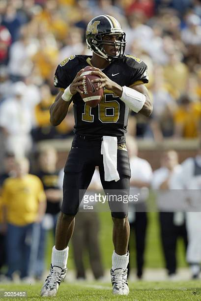 Quarterback Brad Smith of the Missouri Tigers looks to pass during the game against the Colorado Buffalos on November 92002 at Faurot Field in...