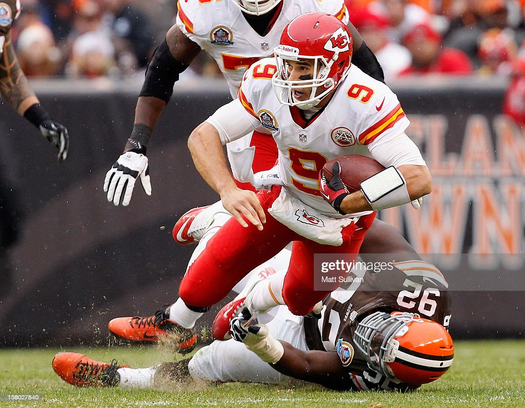 Quarterback Brady Quinn #9 of the Kansas City Chiefs is sacked by defensive lineman Frostee Rucker #92 of the Cleveland Browns at Cleveland Browns Stadium on December 9, 2012 in Cleveland, Ohio.