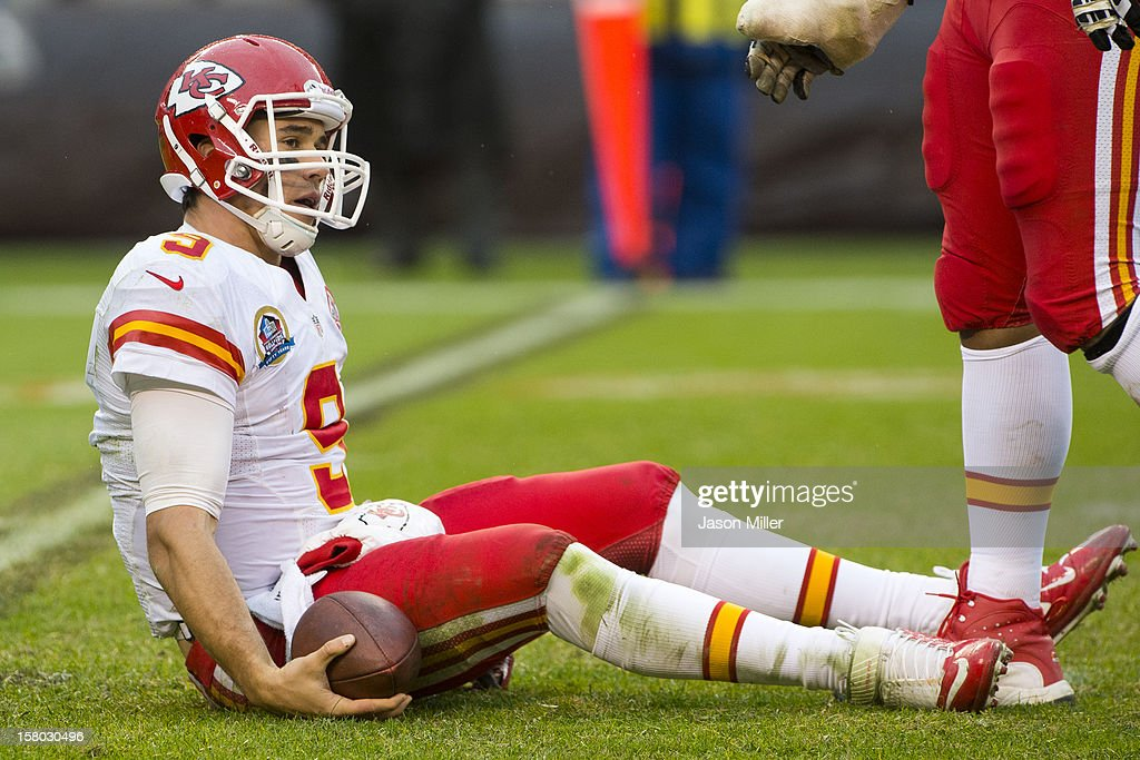 Quarterback Brady Quinn #9 of the Kansas City Chiefs sits on the ground after being sacked during the second half against the Cleveland Browns at Cleveland Browns Stadium on December 9, 2012 in Cleveland, Ohio. The Browns defeated the Chiefs 30-7.