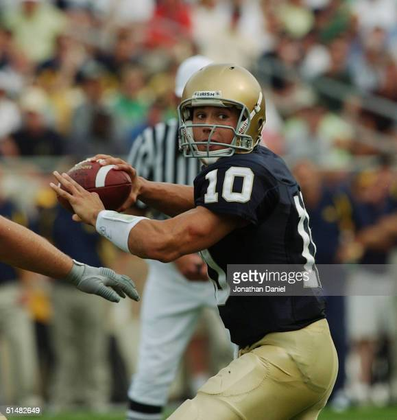 Quarterback Brady Quinn of the Notre Dame Fighting Irish drops back to pass during a game with the Michigan Wolverines on September 11, 2004 at Notre...