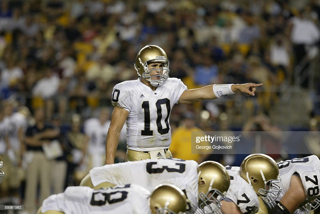 Quarterback Brady Quinn #10 of the Notre Dame Fighting Irish gestures at the line of scrimmage against the University of Pittsburgh Panthers at Heinz Field on September 3, 2005 in Pittsburgh, Pennsylvania. Notre Dame defeated Pittsburgh 42-21.