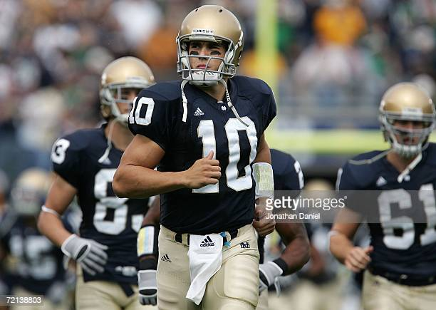 Quarterback Brady Quinn of the Notre Dame Fighting Irish leads his teammates onto the field against the Purdue Boilermakers September 30, 2006 at...