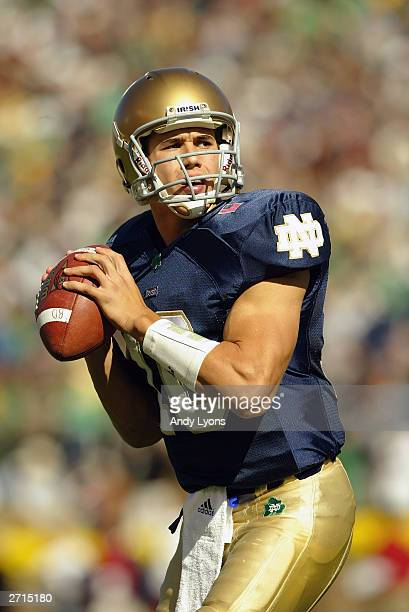 Quarterback Brady Quinn of the Notre Dame Fighting Irish looks to throw against the USC Trojans on October 18 2003 at Notre Dame Stadium in South...