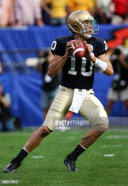Quarterback Brady Quinn of the Notre Dame Fighting Irish looks to pass the ball against the Ohio State Buckeyes at the Tostito's Fiesta Bowl at Sun...