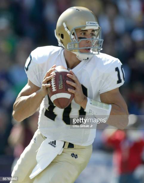Quarterback Brady Quinn of the Notre Dame Fighting Irish rolls out to pass against the Washington Huskies on September 24, 2005 at Husky Stadium in...