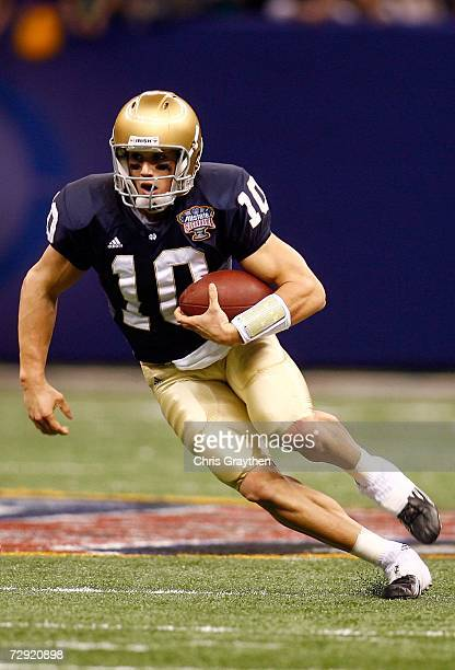 Quarterback Brady Quinn of the Notre Dame Fighting Irish runs with the ball in the first half of the 2007 Allstate Sugar Bowl against the LSU Tigers...