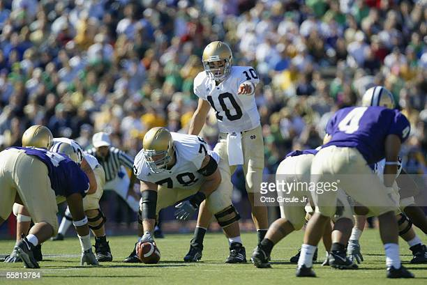 Quarterback Brady Quinn of the University of Notre Dame Fighting Irish waits for the snap from offensive lineman John Sullivan during the game...
