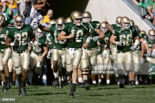 Quarterback Brady Quinn of the University of Notre Dame Fighting Irish leads his team onto the field for the game against the University of Southern...