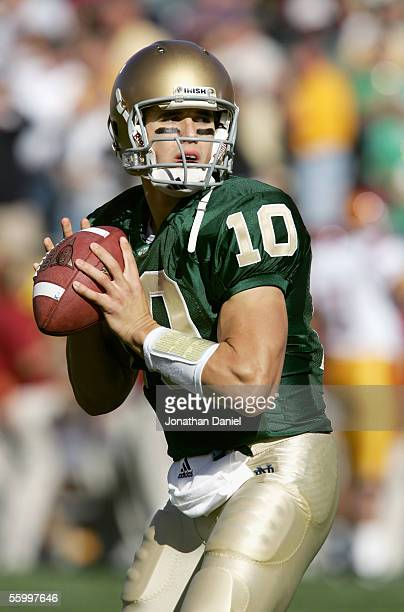Quarterback Brady Quinn of the University of Notre Dame Fighting Irish looks for an open receiver during the game against the University of Southern...