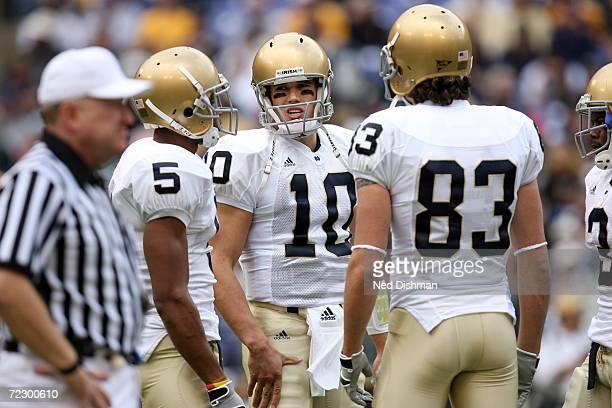Quarterback Brady Quinn wide receiver Rhema McKnight and wide receiver Jeff Samardzija of the Notre Dame Fighting Irish speak on the field against...