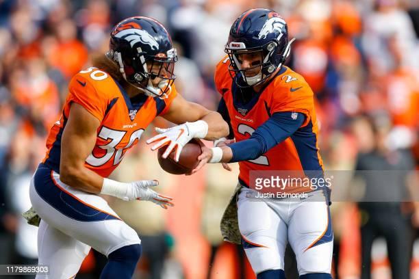 Quarterback Brandon Allen of the Denver Broncos hands the football off to running back Phillip Lindsay during the first quarter against the Cleveland...