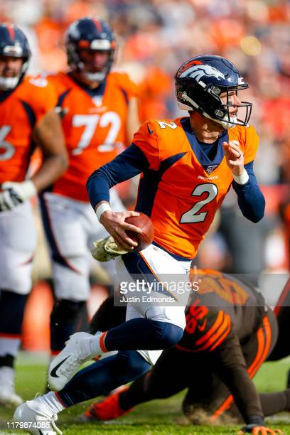 Quarterback Brandon Allen of the Denver Broncos scrambles with the football during the first quarter against the Cleveland Browns at Empower Field at...