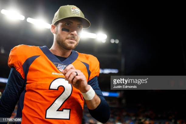 Quarterback Brandon Allen of the Denver Broncos walks on the field after the game against the Cleveland Browns at Empower Field at Mile High on...