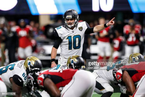 Quarterback Brandon Allen of the Jacksonville Jaguars at the line of scrimmage during a preseason game against the Atlanta Falcons at MercedesBenz...