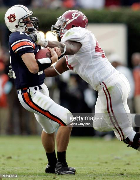 Quarterback Brandon Cox of Auburn University is sacked by Mark Anderson of the University of Alabama on November 19 2005 at JordanHare Stadium in...