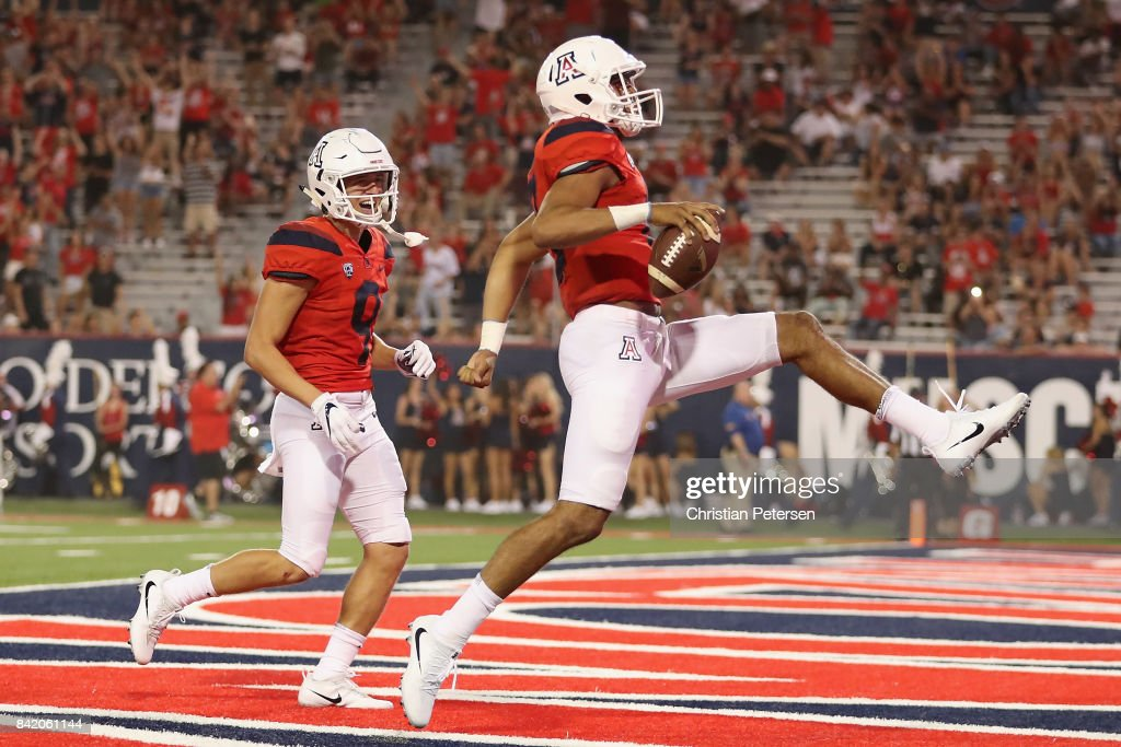Quarterback Brandon Dawkins #13 of the Arizona Wildcats high steps into the endzone on a disallowed touchdown due to a holding penalty during the first half of the college football game against the Northern Arizona Lumberjacks at Arizona Stadium on September 2, 2017 in Tucson, Arizona.