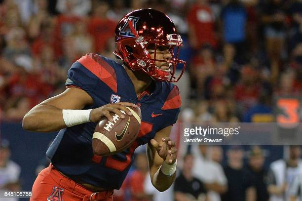 Quarterback Brandon Dawkins of the Arizona Wildcats looks to make a pass in the game against the Houston Cougars at Arizona Stadium on September 9...