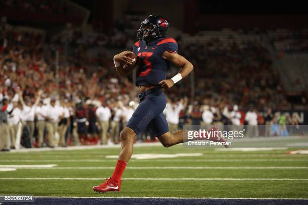Quarterback Brandon Dawkins of the Arizona Wildcats scores on a one yard rushing touchdown against the Utah Utes during the first half of the college...