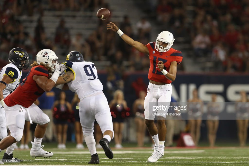 Quarterback Brandon Dawkins #13 of the Arizona Wildcats throws a pass during the first half of the college football game against the Northern Arizona Lumberjacks at Arizona Stadium on September 2, 2017 in Tucson, Arizona.