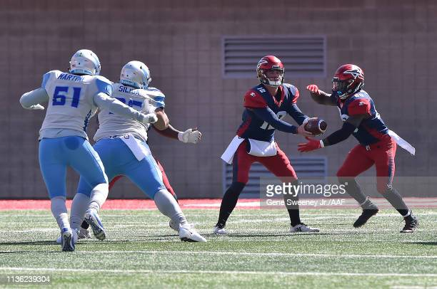 Quarterback Brandon Silvers of the Memphis Express hands off the ball to Zac Stacy as they take on the Salt Lake Stallions at Rice Eccles Stadium on...
