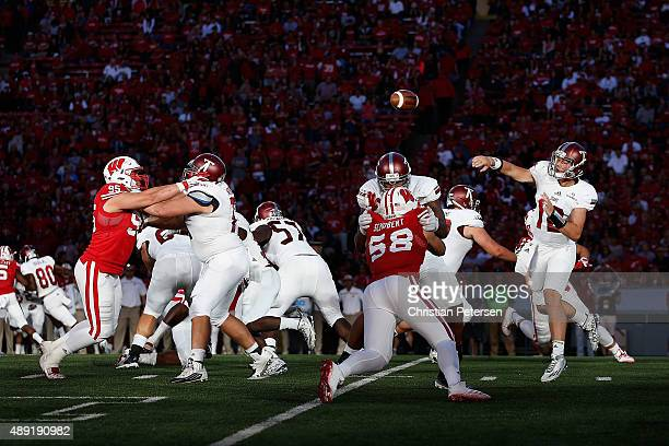 Quarterback Brandon Silvers of the Troy Trojans throws a pass during the fourth quarter of the college football game against the Wisconsin Badgers at...