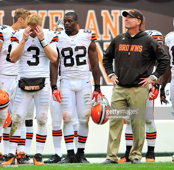 Quarterback Brandon Weeden and head coach Pat Shurmur of the Cleveland Browns reacts to having thrown an interception late in the 4th quarter during...