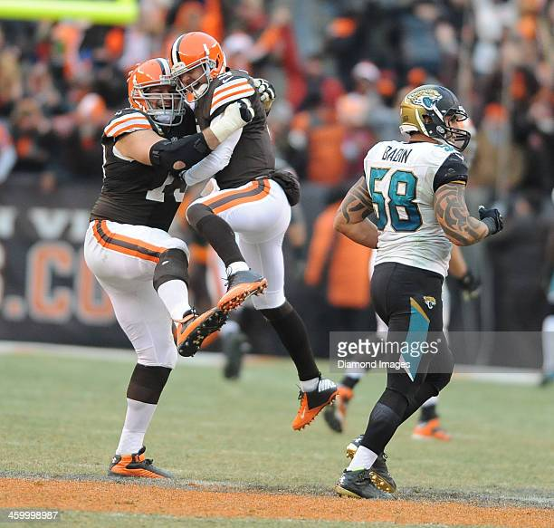 Quarterback Brandon Weeden and offensive linemen Joe Thomas of the Cleveland Browns celebrate after a Weeden touchdown pass during a game against the...