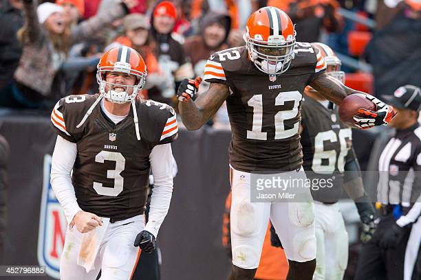 Quarterback Brandon Weeden and wide receiver Josh Gordon of the Cleveland Browns celebrate after Gordon scored a touchdown on a pass from Weeden...