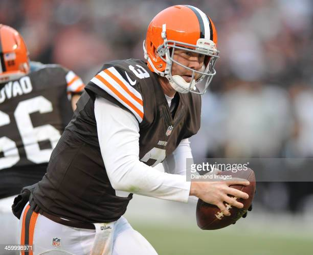 Quarterback Brandon Weeden of the Cleveland Browns does a ball fake on a play action pass during a game against the Jacksonville Jaguars at...