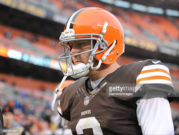 Quarterback Brandon Weeden of the Cleveland Browns frowns while walking to the locker room after a game against the Jacksonville Jaguars at...