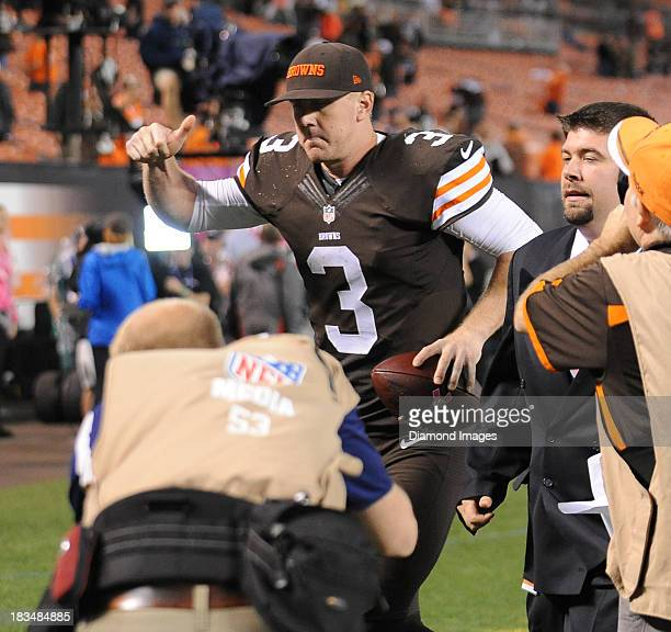 Quarterback Brandon Weeden of the Cleveland Browns gives the thumbs up as he jogs off the field after a gams against the Buffalo Bills at FirstEnergy...