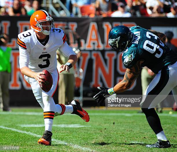 Quarterback Brandon Weeden of the Cleveland Browns is hurried by defensive linemen Jason Babin of the Philadelphia Eagles during a game with the...