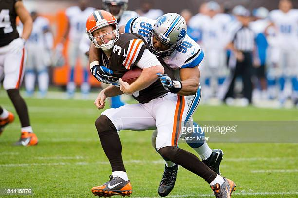 Quarterback Brandon Weeden of the Cleveland Browns is sacked by defensive tackle Ndamukong Suh of the Detroit Lions during the second half at...