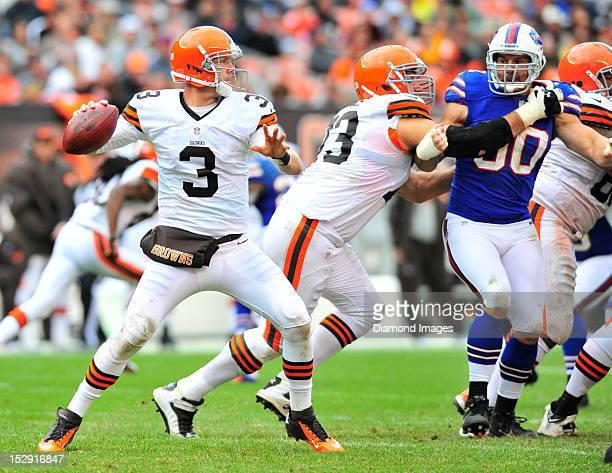 Quarterback Brandon Weeden of the Cleveland Browns sets up to pass during a game with the Buffalo Bills at Cleveland Browns Stadium in Cleveland Ohio...