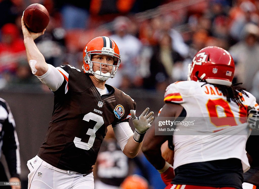 Quarterback Brandon Weeden #3 of the Cleveland Browns throws to a receiver over defensive end Tyson Jackson #94 of the Kansas City Chiefs at Cleveland Browns Stadium on December 9, 2012 in Cleveland, Ohio.