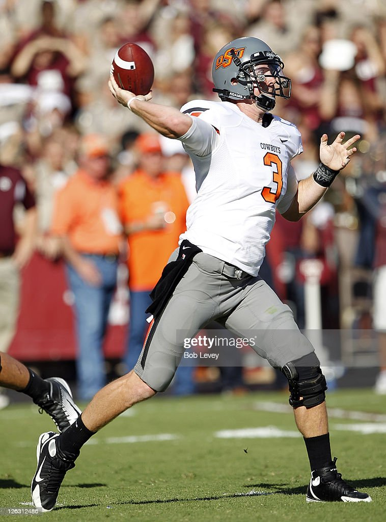 Quarterback Brandon Weeden #3 of the Oklahoma State Cowboys throws to a receiver down-field against the Texas A&M Aggies at Kyle Field on September 24, 2011 in College Station, Texas. Oklahoma State won 30-29.