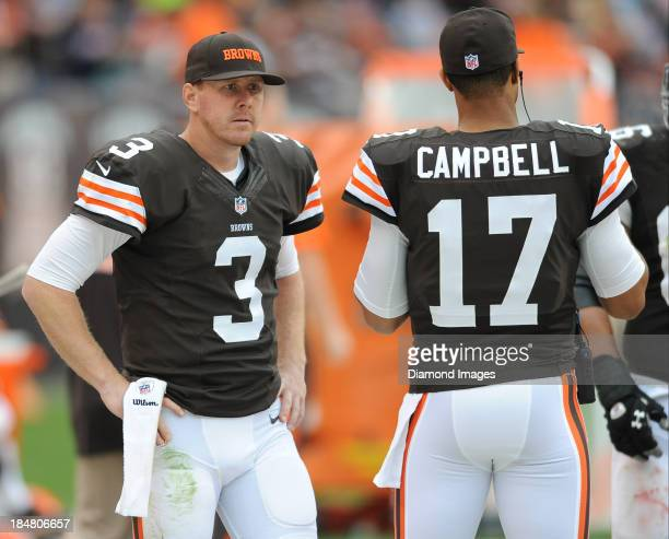 Quarterback Brandon Weeden talks to quarterback Jason Campbell of the Cleveland Browns on the sideline during a game against the Detroit Lions at...