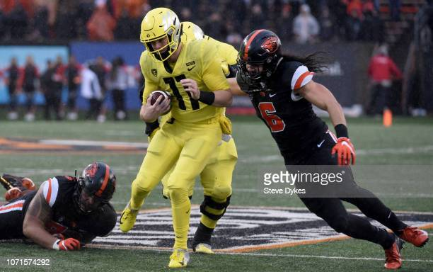 Quarterback Braxton Burmeister of the Oregon Ducks runs into cornerback Jay Irvine of the Oregon State Beavers during the second half of the game at...