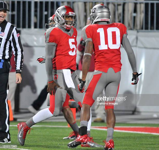 Quarterback Braxton Miller and receiver Corey Brown of the Ohio State Buckeyes celebrate after a touchdown during a game with the Wisconsin Badgers...