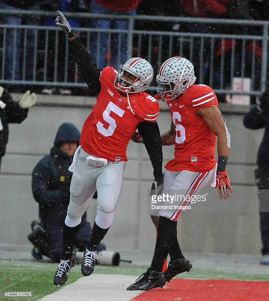 Quarterback Braxton Miller and receiver Evan Spencer of the Ohio State Buckeyes celebrates after scoring a touchdown during a game against the...