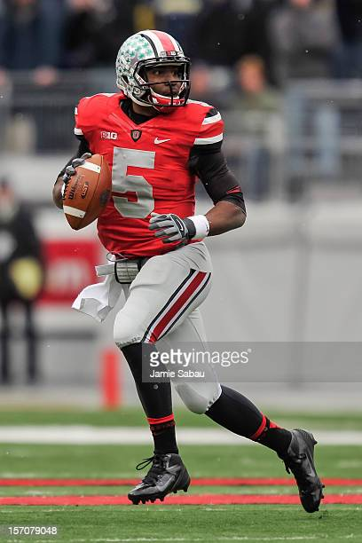 Quarterback Braxton Miller of the Ohio State Buckeyes controls the ball against the Michigan Wolverines at Ohio Stadium on November 24, 2012 in...