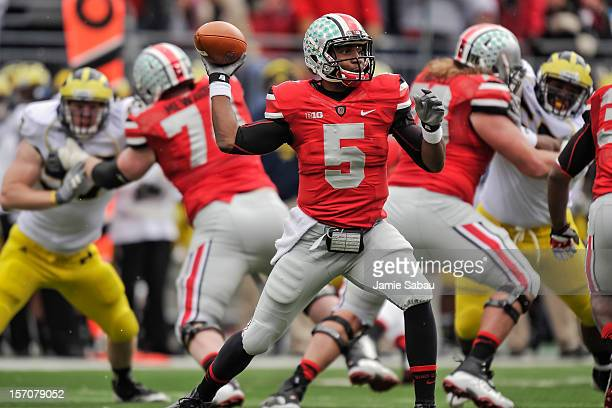 Quarterback Braxton Miller of the Ohio State Buckeyes controls the ball against the Michigan Wolverines at Ohio Stadium on November 24 2012 in...