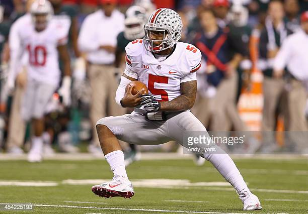 Quarterback Braxton Miller of the Ohio State Buckeyes looks to run during the Big Ten Conference Championship game against the Michigan State...