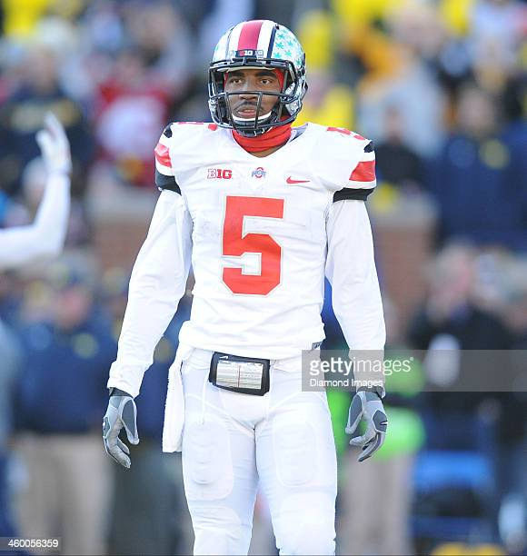 Quarterback Braxton Miller of the Ohio State Buckeyes looks to the sideline for the play during a game against the Michigan Wolverines at Michigan...