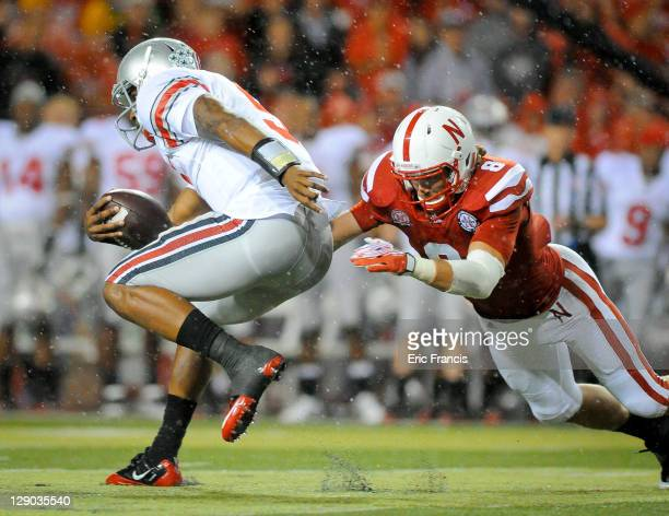 Quarterback Braxton Miller of the Ohio State Buckeyes runs past safety Austin Cassidy of the Nebraska Cornhuskers during their game at Memorial...