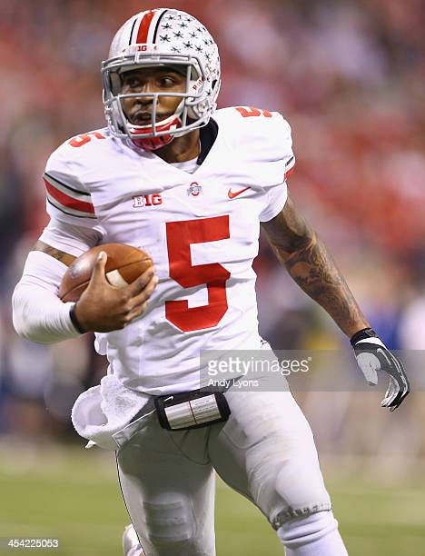 Quarterback Braxton Miller of the Ohio State Buckeyes rushes for a touchdown against the Michigan State Spartans in the third quarter of the Big Ten...
