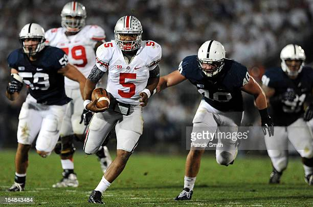 Quarterback Braxton Miller of the Ohio State Buckeyes rushes past linebacker Glenn Carson of the Penn State Nittany Lions in the second quarter at...