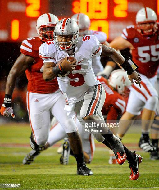 Quarterback Braxton Miller of the Ohio State Buckeyes slips past the Nebraska Cornhuskers during their game at Memorial Stadium October 8, 2011 in...